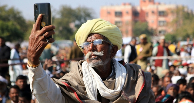 A farmer takes a selfie with a smartphone at a rally in Jaipur, India. (Vishal Bhatnagar/AFP/Getty Images)